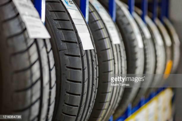 stack of car tires - タイヤ ストックフォトと画像