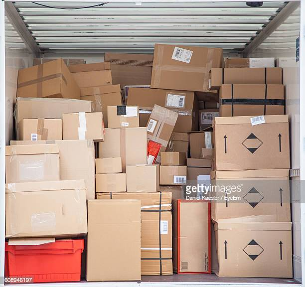 Stack Of Cardboard Boxes In Cargo Container