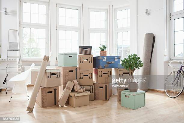 Stack of cardboard boxes in empty apartment