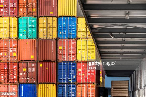 stack of cargo containers - cargo train stock photos and pictures