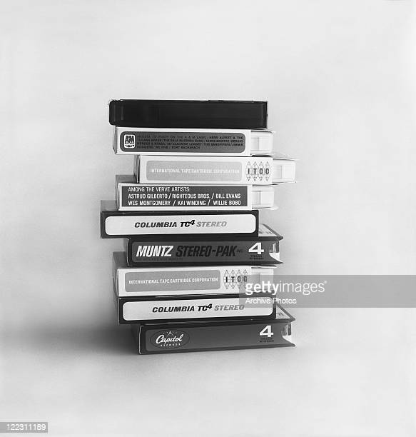 Stack of cassette tapes against white background, close-up