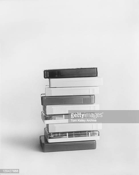 Stack of cassette tapes on white background, close-up