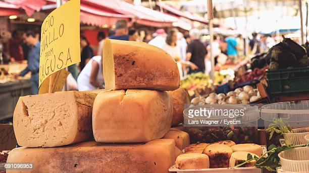 Stack Of Cheese At Market For Sale
