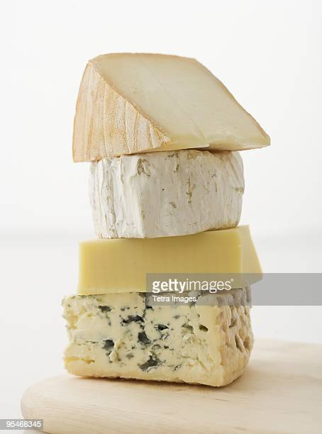 a stack of cheese - cheese stock pictures, royalty-free photos & images