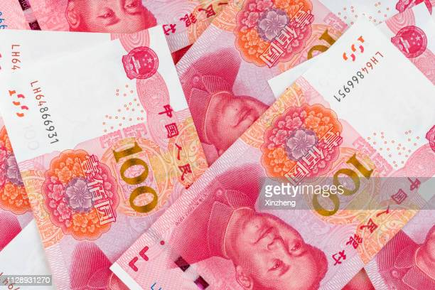 stack of chinese rmb paper currency - mao tsé toung stockfoto's en -beelden
