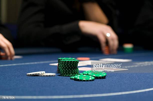 a stack of chips on casino table - texas hold 'em stock pictures, royalty-free photos & images
