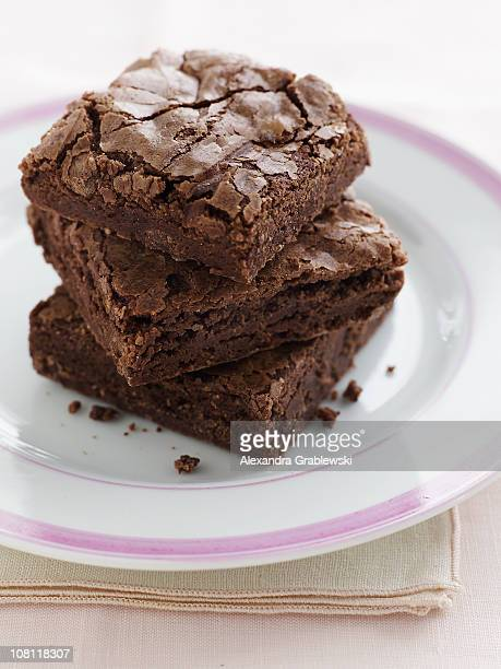 stack of chocolate brownies - brownie stock pictures, royalty-free photos & images