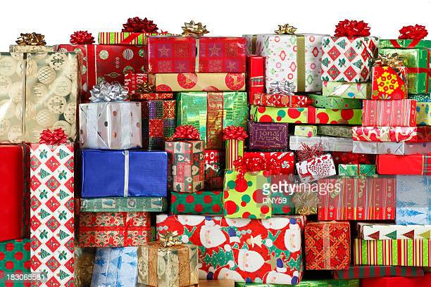 stack of christmas presents - christmas gifts stock photos and pictures