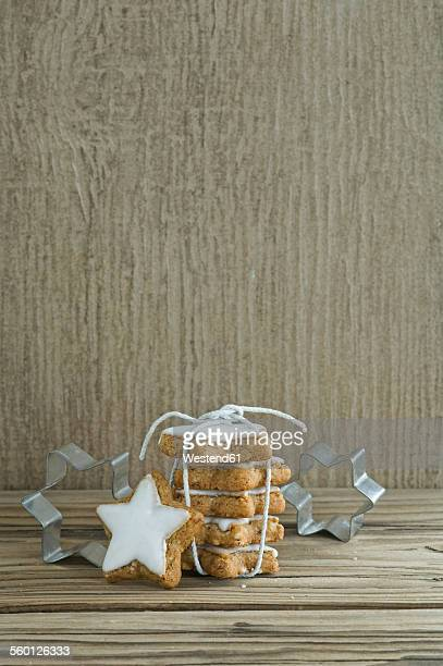 Stack of cinnamon stars and cookie cutters