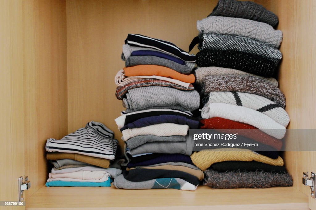 Stack Of Clothes In Shelf At Home : Stock Photo