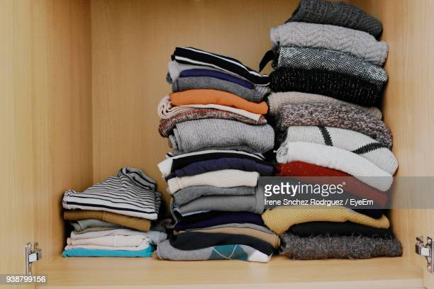 Stack Of Clothes In Shelf At Home