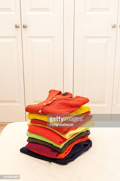 stack of clothing - top garment stock pictures, royalty-free photos & images