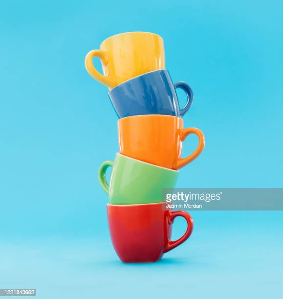 stack of coffee cups on blue pastel background - stack stock pictures, royalty-free photos & images