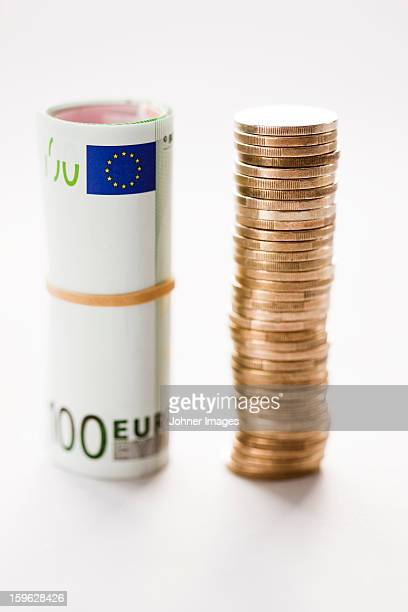 Stack of coins with banknote
