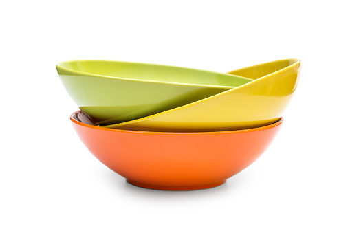 Stack of colorful bowls on white. 1094618224