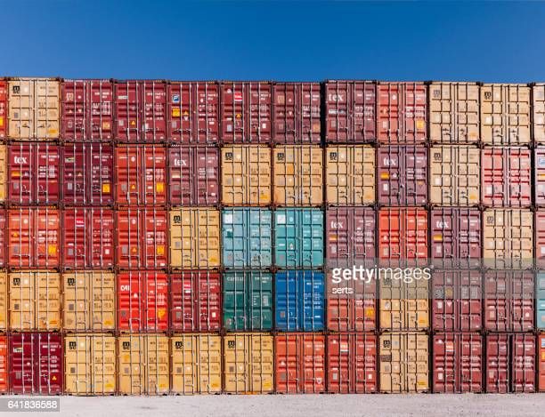 stack of colorful cargo containers at the dock - container stock pictures, royalty-free photos & images