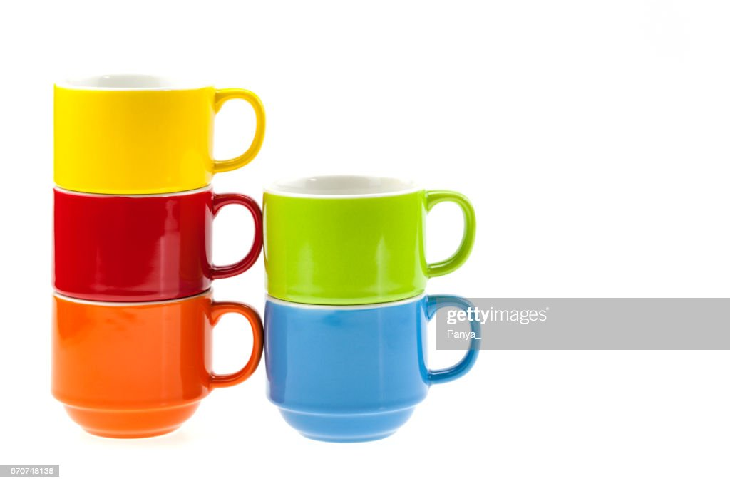 stack of colorful coffee cups isolated on white background stock