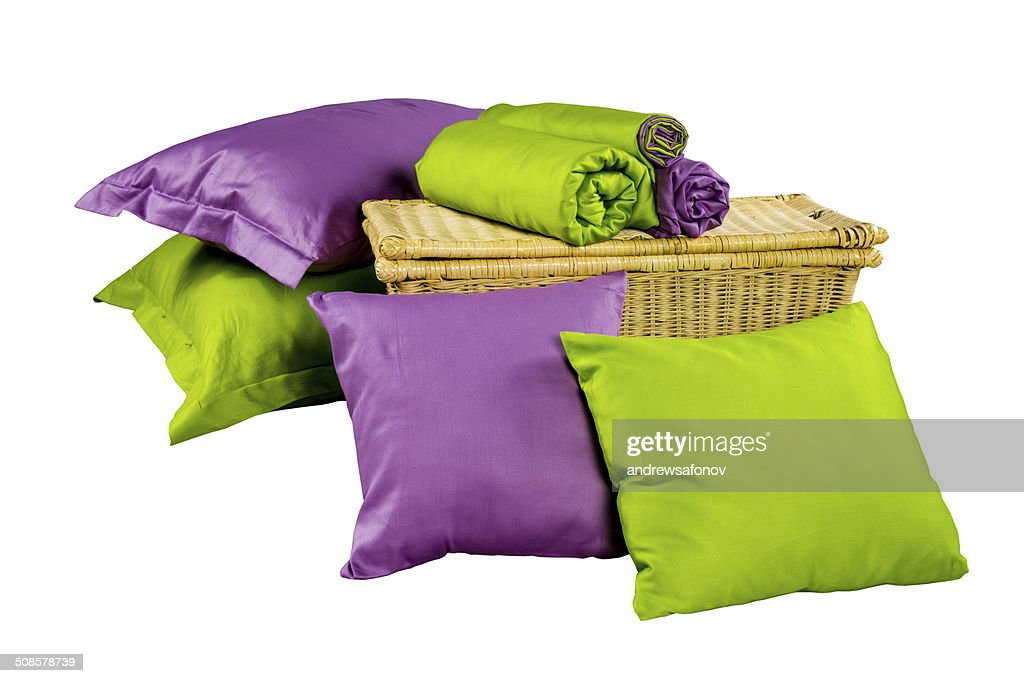 stack of colorful pillows and twisted blankets on baskets : Stockfoto