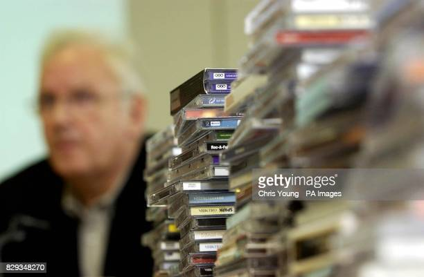 A stack of compact discs sit infront of music impressario Pete Waterman as he attends a press conference at the British Phonographic Industry's...