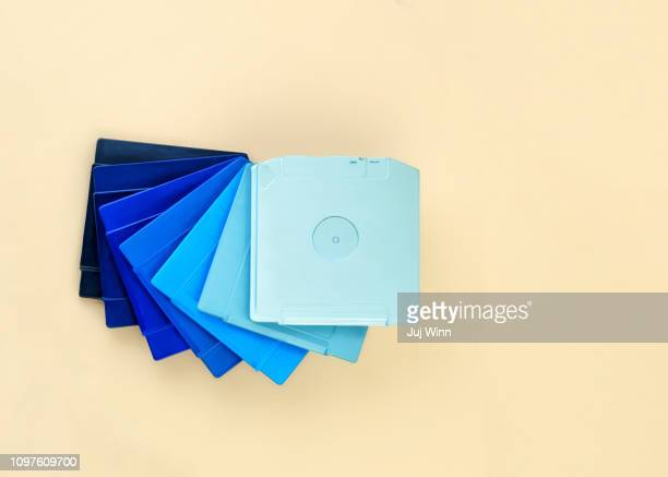 Stack of computer disk drives painted in a blue gradient