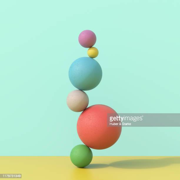 stack of concrete spheres - hovering stock pictures, royalty-free photos & images