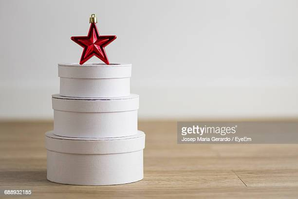 Stack Of Containers With Star Shape Decoration On Table