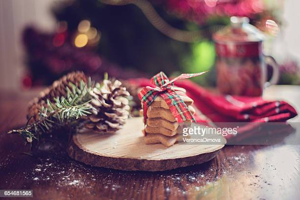 Stack of cookies with pine cones and christmas tree
