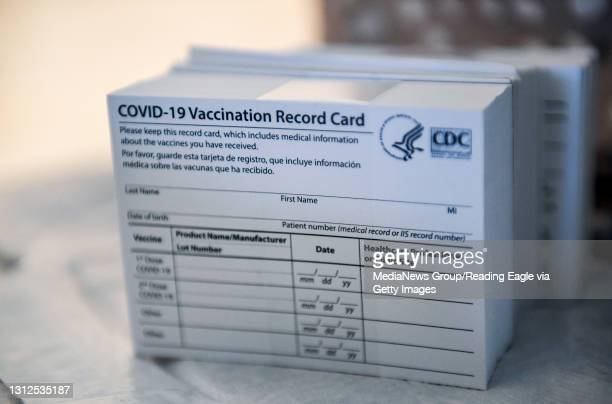 Stack of COVID-19 Vaccination Record Cards from the CDC. At the Giorgio Companies site in Blandon, PA where the CATE Mobile Vaccination Unit was...
