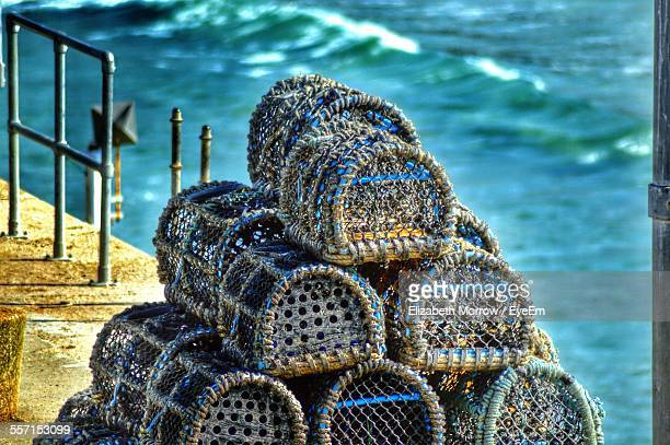 stack of crab pots - crab pot stock photos and pictures