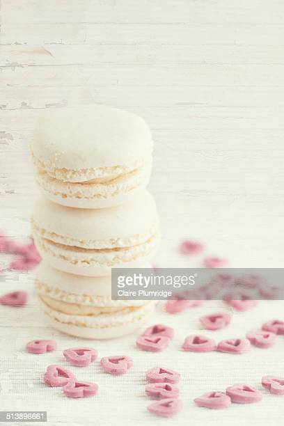 stack of cream macaroons - claire plumridge stock pictures, royalty-free photos & images