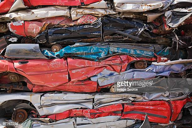 stack of crushed cars - junkyard stock photos and pictures