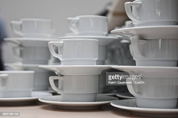 Stack Of Cups And Saucers On Table