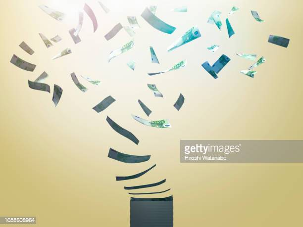 stack of currencies blowing away. ( euro ) - à profusion photos et images de collection