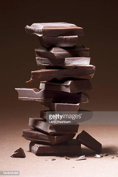 a stack of dark chocolate - ダークチョコレート ストックフォトと画像