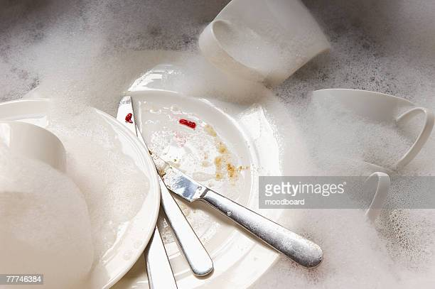 Stack of Dirty Dishes in Sink