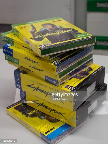 Stack of discs for different platforms for issuing to the customers who made a preorder. Cyberpunk 2077 has been started on sale worldwide. In Russia...