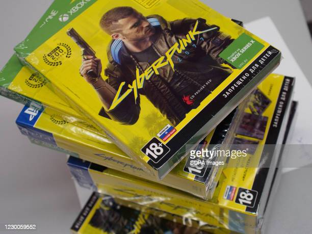Stack of discs for platforms PC, XBox and PlayStation for issuing to the customers who made a preorder. Cyberpunk 2077 has been started on sale...