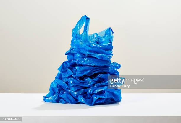a stack of disposable plastic bags - large group of objects stock pictures, royalty-free photos & images