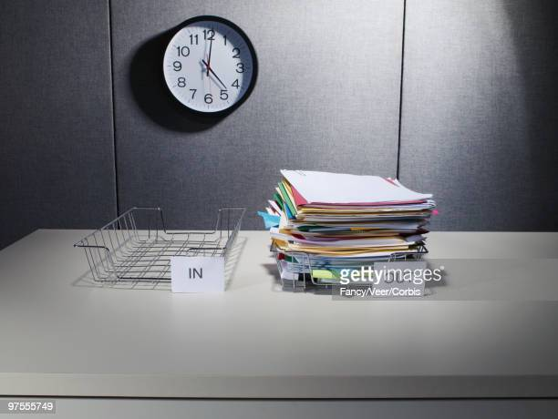 Stack of Documents in Out Box