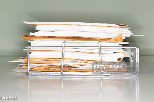 Stack of documents on tray