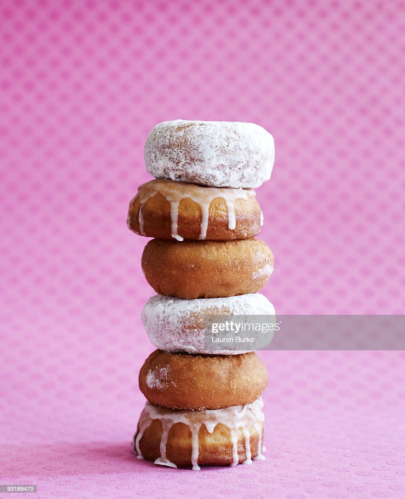Stack of Donuts on Pink Background : Stock Photo