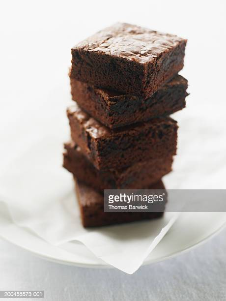 Stack of double-chocolate brownies on plate