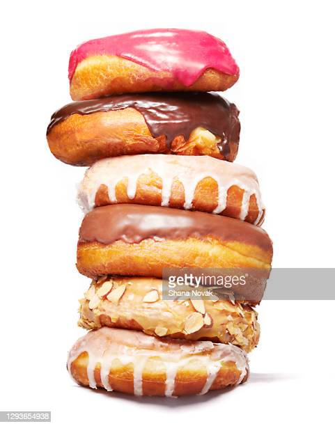 "stack of doughnuts - ""shana novak"" stock pictures, royalty-free photos & images"