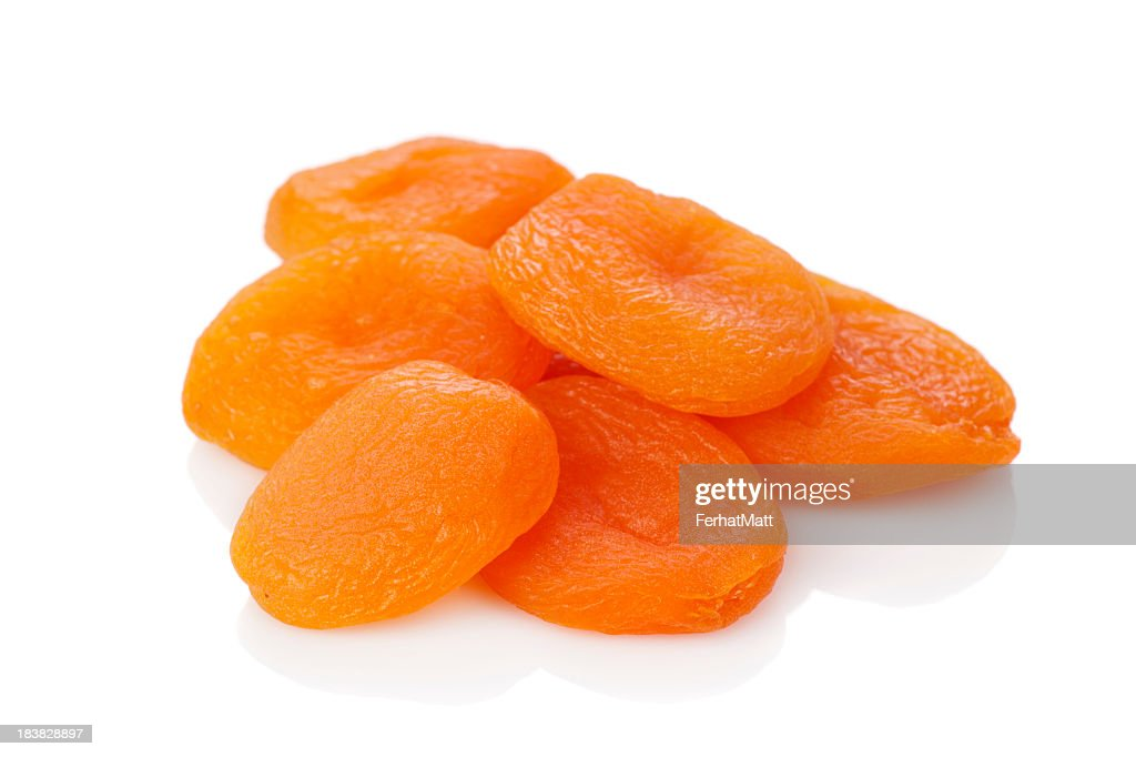 A stack of dried apricots against a white background : Stock Photo