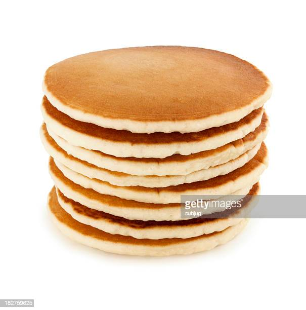 stack of eight buttermilk pancakes on a white table - pancake stock pictures, royalty-free photos & images