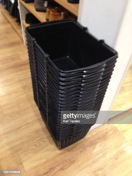 a stack of empty baskets on a store floor - capital region stock pictures, royalty-free photos & images