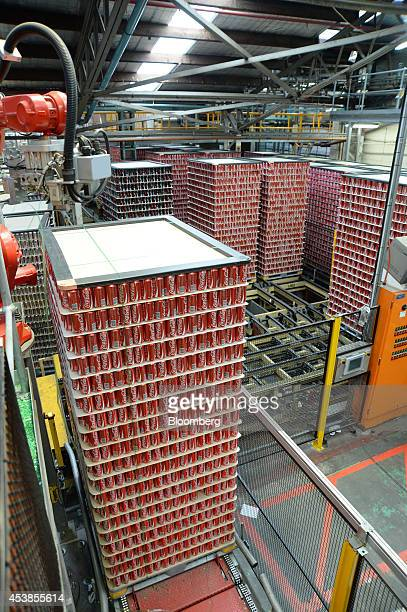 A stack of empty CocaCola Classic cans move along a conveyor towards the filling area at a CocaCola Amatil Ltd production facility in Melbourne...
