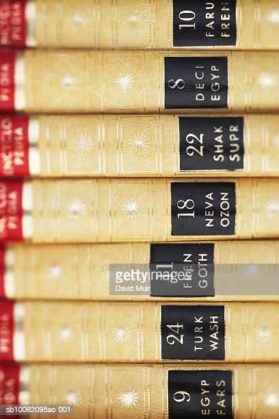 stack of encyclopaedia volumes, detail of spines - enzyklopädie stock-fotos und bilder