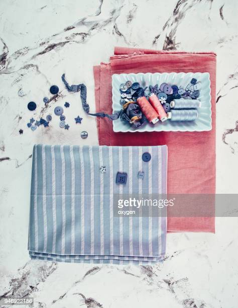 stack of fabrics over white marble table - ribbon sewing item stock pictures, royalty-free photos & images