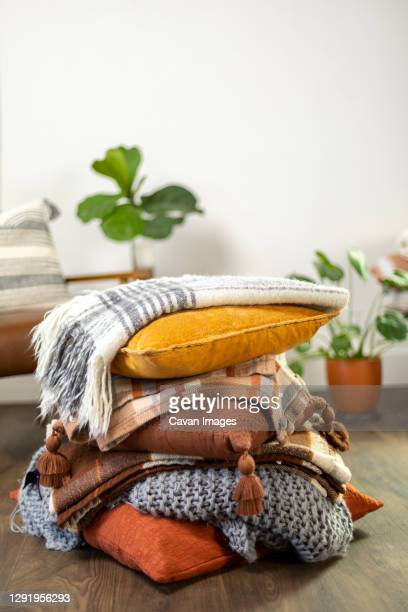 stack of fall pillows with blankets - pillow stock pictures, royalty-free photos & images